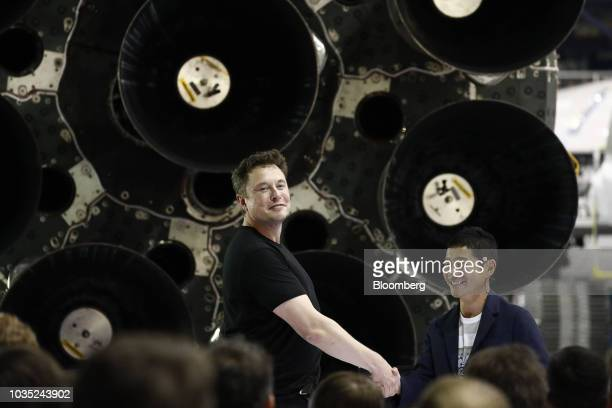 Elon Musk chief executive officer for Space Exploration Technologies Corp left shakes hands with Yusaku Maezawa founder and president of Start Today...