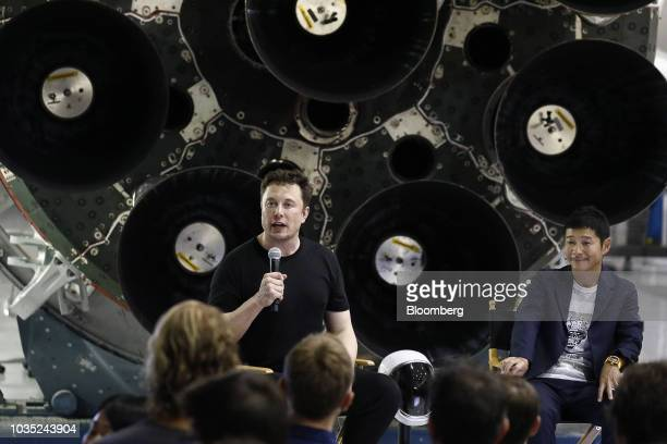 Elon Musk chief executive officer for Space Exploration Technologies Corp left speaks as Yusaku Maezawa founder and president of Start Today Co looks...