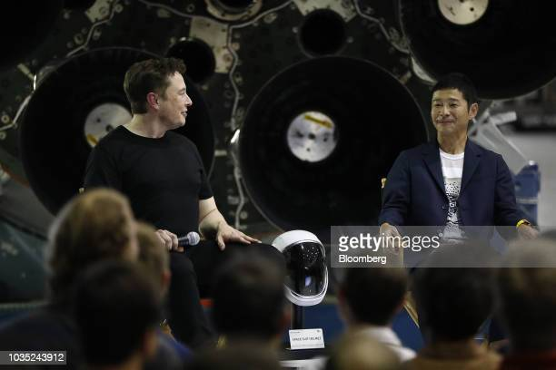 Elon Musk chief executive officer for Space Exploration Technologies Corp left looks towards Yusaku Maezawa founder and president of Start Today Co...