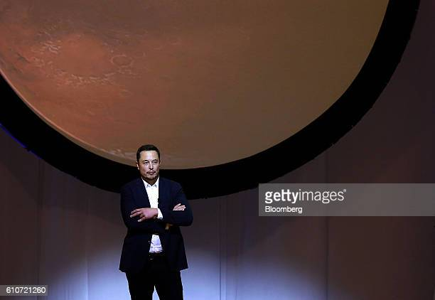 Elon Musk chief executive officer for Space Exploration Technologies Corp pauses while speaking during the 67th International Astronautical Congress...