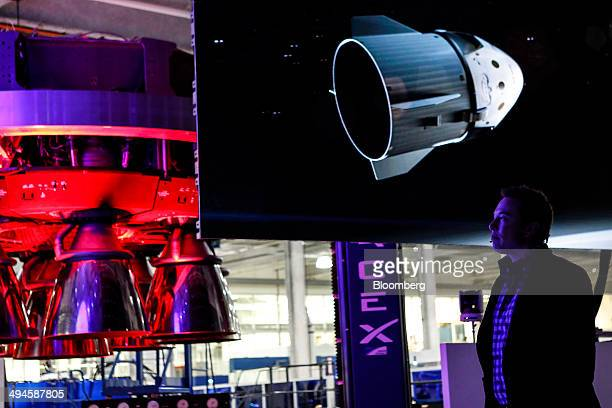 Elon Musk chief executive officer of Space Exploration Technologies Corp watches a video at the unveiling of the Manned Dragon V2 Space Taxi in...