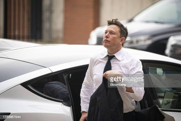 Elon Musk, chief executive officer of Tesla Inc., arrives at court during the SolarCity trial in Wilmington, Delaware, U.S., on Tuesday, July 13,...