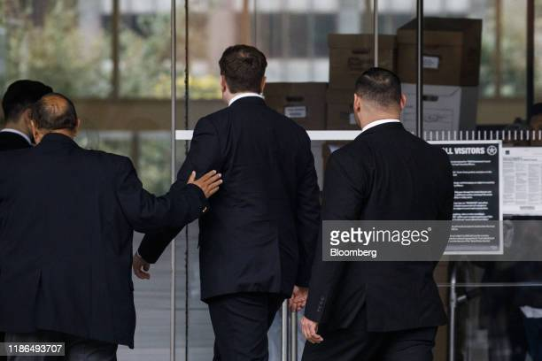 Elon Musk chief executive officer of Tesla Inc center arrives to federal court in Los Angeles California US on Wednesday Dec 4 2019 British...