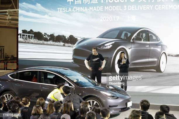 Elon Musk chief executive officer of Tesla Inc center attends the Tesla ChinaMade Model 3 Delivery Ceremony at the company's Gigafactory in Shanghai...