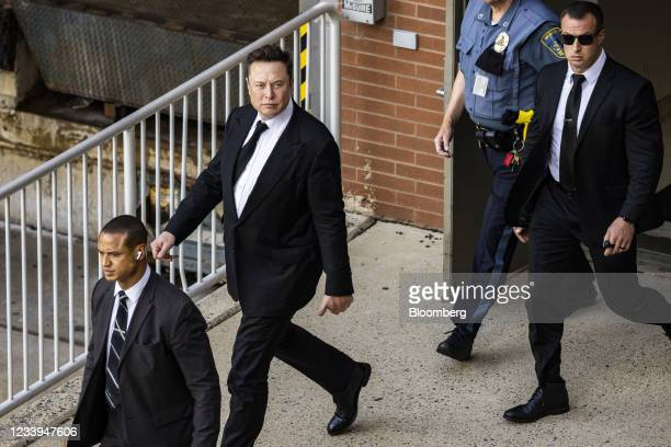 Elon Musk, chief executive officer of Tesla Inc., center, departs from court for the SolarCity trial in Wilmington, Delaware, U.S., on Monday, July...