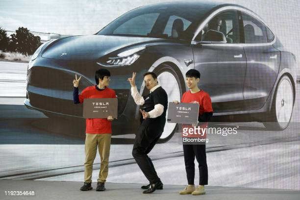 Elon Musk chief executive officer of Tesla Inc gestures during the Tesla ChinaMade Model 3 Delivery Ceremony at the company's Gigafactory in Shanghai...
