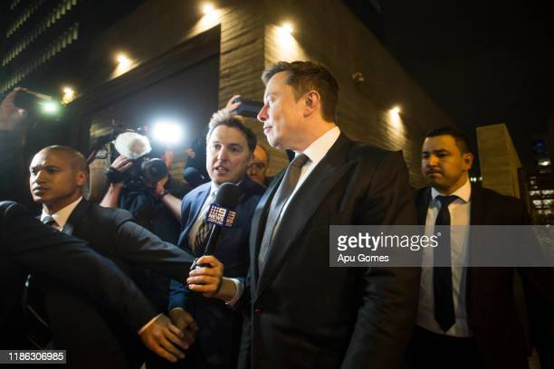 Elon Musk chief executive officer of Tesla Inc leaves the US District Court Central District of California through a back door in Los Angeles US on...