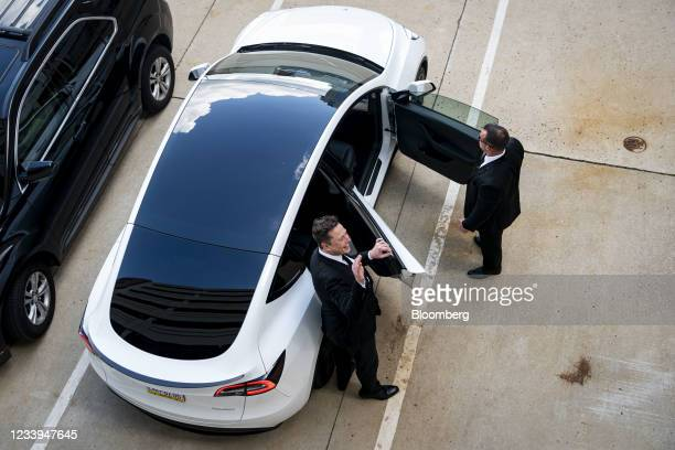 Elon Musk, chief executive officer of Tesla Inc., left, departs from court for the SolarCity trial in Wilmington, Delaware, U.S., on Monday, July 12,...