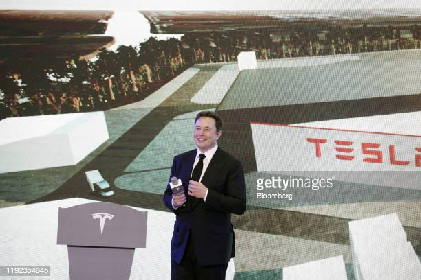 Elon Musk chief executive officer of Tesla Inc pauses while speaking during the Tesla ChinaMade Model 3 Delivery Ceremony at the company's...