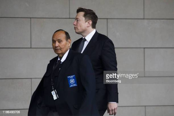 Elon Musk chief executive officer of Tesla Inc right arrives to federal court in Los Angeles California US on Wednesday Dec 4 2019 British...