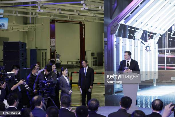 Elon Musk chief executive officer of Tesla Inc right attends the Tesla ChinaMade Model 3 Delivery Ceremony at the company's Gigafactory in Shanghai...