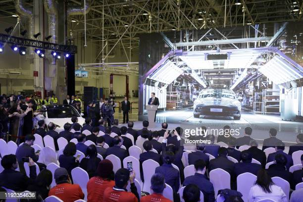 Elon Musk chief executive officer of Tesla Inc speaks during the Tesla ChinaMade Model 3 Delivery Ceremony at the company's Gigafactory in Shanghai...