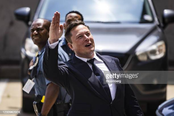 Elon Musk, chief executive officer of Tesla Inc., waves while departing court during the SolarCity trial in Wilmington, Delaware, U.S., on Tuesday,...
