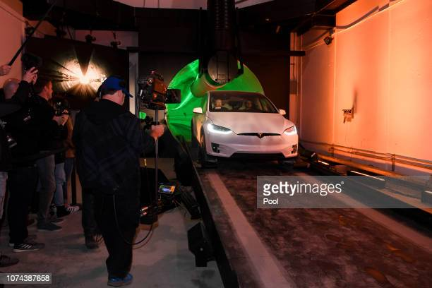 Elon Musk cofounder and Chief Executive Officer of Tesla Inc arrives in a modified Tesla Model X electric vehicle during an unveiling event for The...
