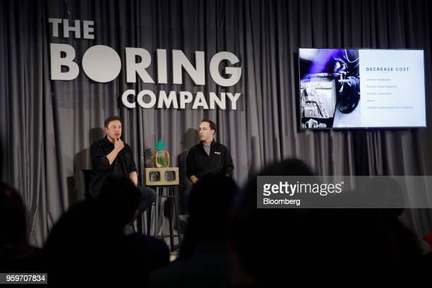 Elon Musk, co-founder and chief executive officer of Tesla Inc., left, speaks as Steve Davis, the operations head of Boring Co., right, listens...