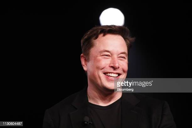 Elon Musk cofounder and chief executive officer of Tesla Inc reacts while speaking during an unveiling event for the Tesla Model Y crossover electric...