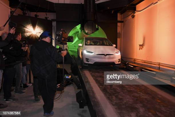 Elon Musk, co-founder and chief executive officer of Tesla Inc., rides in the passenger seat of a modified Tesla Model X electric vehicle as he...
