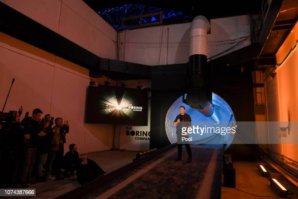 Elon Musk cofounder and Chief Executive Officer of Tesla Inc speaks at an unveiling event for The Boring Company Hawthorne test tunnel December 18...