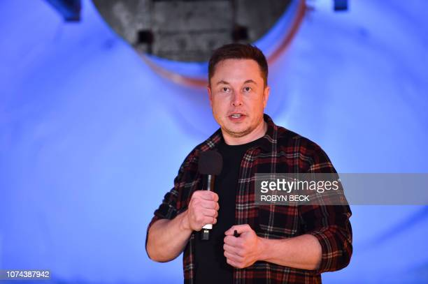 Elon Musk, co-founder and chief executive officer of Tesla Inc., speaks during an unveiling event for the Boring Company Hawthorne test tunnel in...