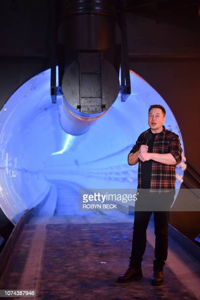Elon Musk cofounder and chief executive officer of Tesla Inc speaks during an unveiling event for the Boring Company Hawthorne test tunnel in...