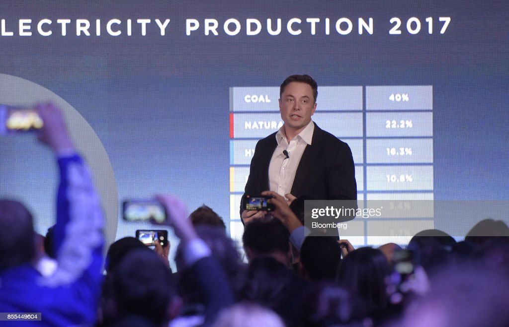 Elon Musk, co-founder and chief executive officer of Tesla Inc., speaks during an event at the Hornsdale wind farm, operated by Neoen SAS, near Jamestown, South Australia, on Friday, Sept. 29, 2017. Against a backdrop of wind turbines 150 miles (241 kilometers) north of Adelaide, Musk announced a contract to build the world's largest lithium-ion battery system had been signed with South Australia's power distributor, triggering a 100-day self-imposed deadline to install the electricity storage system. Photographer: Carla Gottgens/Bloomberg via Getty Images
