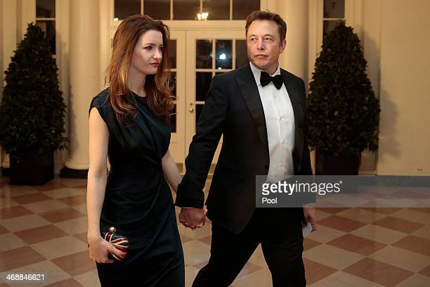 Elon Musk cofounder and chief executive officer of Tesla Motors Inc right and Talulah Musk arrive to a state dinner hosted by US President Barack...