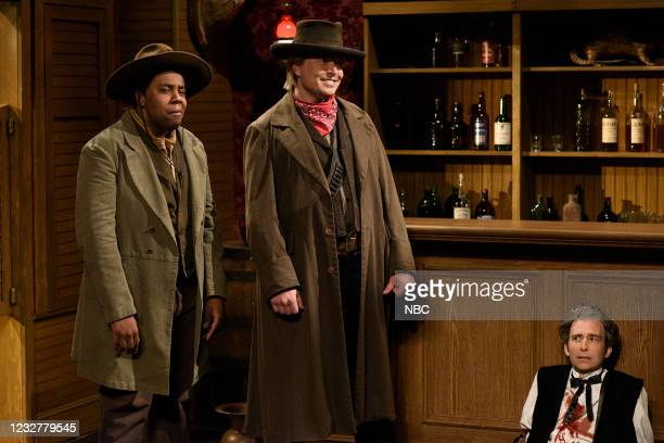 """Elon Musk"""" Episode 1803 -- Pictured: Kenan Thompson, host Elon Musk, and Kyle Mooney during the """"Cowboy Standoff"""" sketch on Saturday, May 8, 2021 --"""