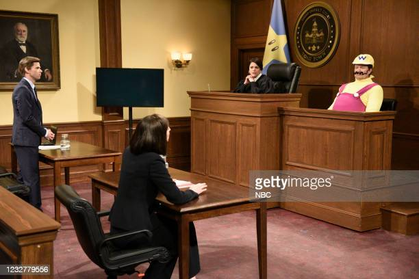 """Elon Musk"""" Episode 1803 -- Pictured: Mikey Day as a lawyer, Cecily Strong as a judge, and host Elon Musk as Wario during the """"Wario"""" sketch on..."""