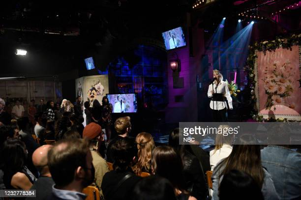 """Elon Musk"""" Episode 1803 -- Pictured: Musical guest Miley Cyrus during the Mother's Day Message Cold Open on Saturday, May 8, 2021 --"""