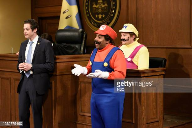 """Elon Musk"""" Episode 1803 -- Pictured: Pete Davidson as Andrew Cuomo, Kenan Thompson as Mario, and host Elon Musk as Wario during the """"Wario"""" sketch on..."""