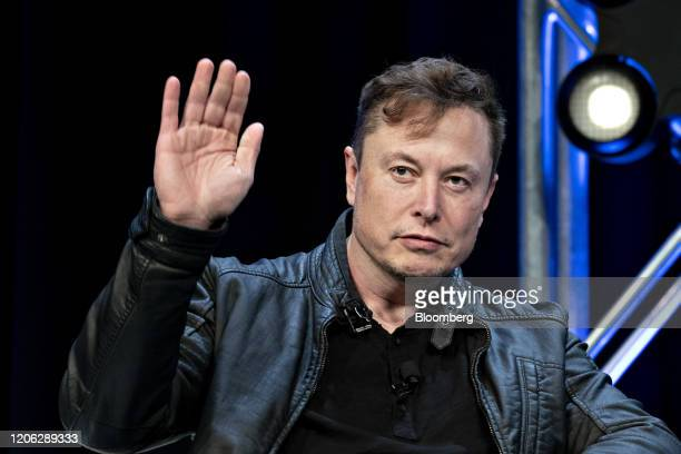 Elon Musk founder of SpaceX and chief executive officer of Tesla Inc waves while arriving to a discussion at the Satellite 2020 Conference in...