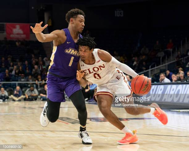 Elon Phoenix Guard Hunter McIntosh dribbles the ball against James Madison Dukes Guard Matt Lewis defending during the second half of the Colonial...