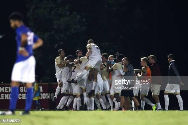 Elon players celebrate a goal by Mikey Thomas The Elon University Phoenix hosted the Presbyterian College Blue Hose on September 2 2017 at Rudd Field...