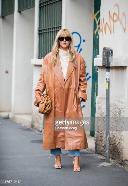 Elonora Carisi seen wearing brown Bottega Veneta pouch bag, leaher coat, white turtleneck outside Boss during Milan Fashion Week Spring/Summer 2020...