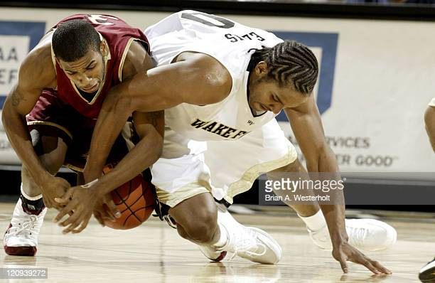 Elon's Montell Watson and Wake Forest's Chris Ellis battle for a loose ball during first half action at the LJVM Coliseum in WinstonSalem NC December...