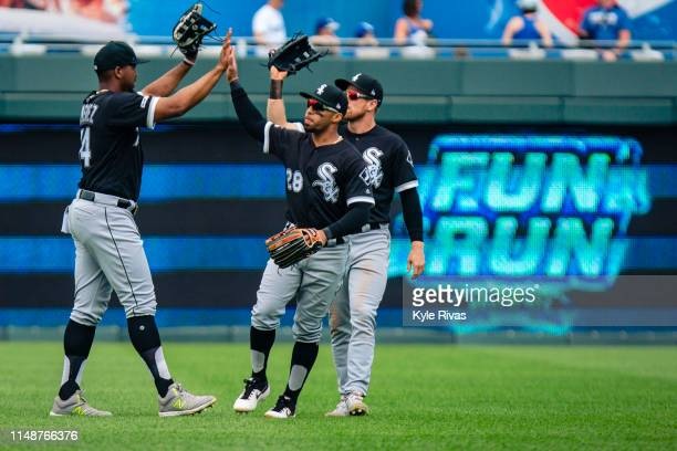 Eloy Jimenez Charlie Tilson and Leury Garcia of the Chicago White Sox celebrate the victory over the Kansas City Royals at Kauffman Stadium on June...