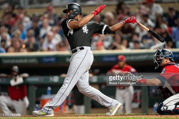 Eloy Jimenez of the Chicago White Sox bats against the Minnesota Twins on August 19 2019 at the Target Field in Minneapolis Minnesota The White Sox...