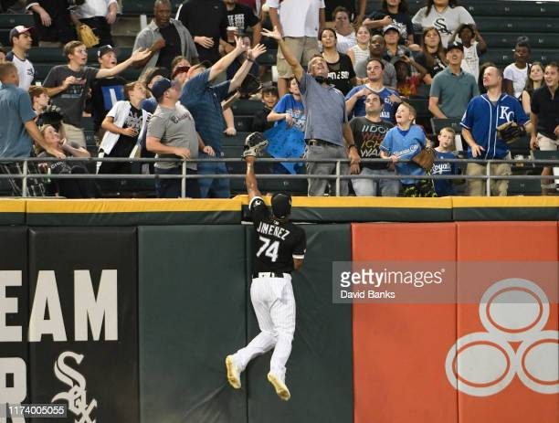 Eloy Jimenez of the Chicago White Sox can't catch a two run home run hit by Jorge Soler of the Kansas City Royals during the first inning at...