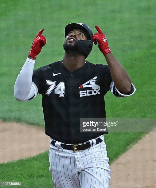 Eloy Jimenez of the Chicago White Sox celebrates after hitting a grand slam home run in the 1st inning against the Chicago Cubs during an exhibition...