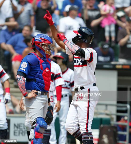 Eloy Jimenez of the Chicago White Sox celebrates following his two run home run during the fourth inning against the Chicago Cubs at Guaranteed Rate...