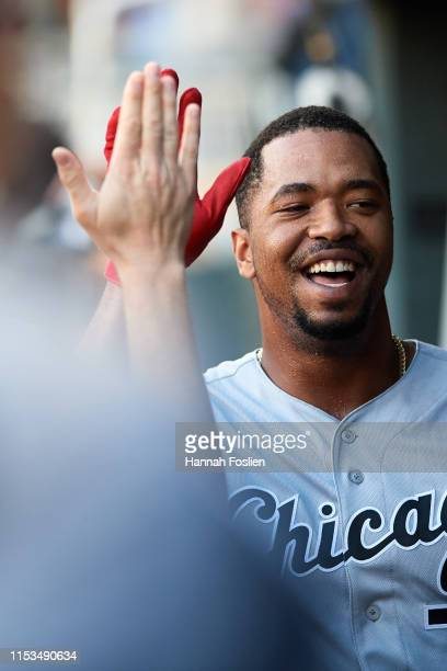 Eloy Jimenez of the Chicago White Sox celebrates scoring a run against the Minnesota Twins during the game on May 24 2019 at Target Field in...