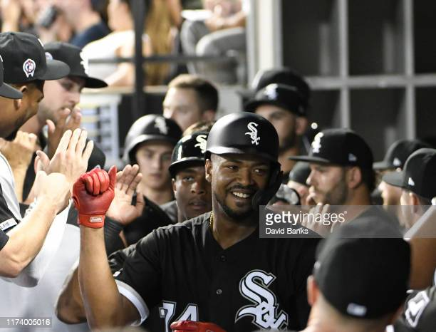 Eloy Jimenez of the Chicago White Sox celebrates with teammates after hitting a threerun home run against the Kansas City Royals during the first...