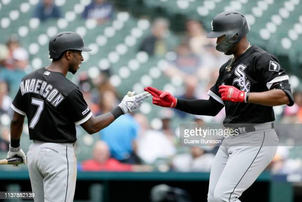 Eloy Jimenez of the Chicago White Sox celebrates with Tim Anderson of the Chicago White Sox after hitting a tworun home run against the Detroit...