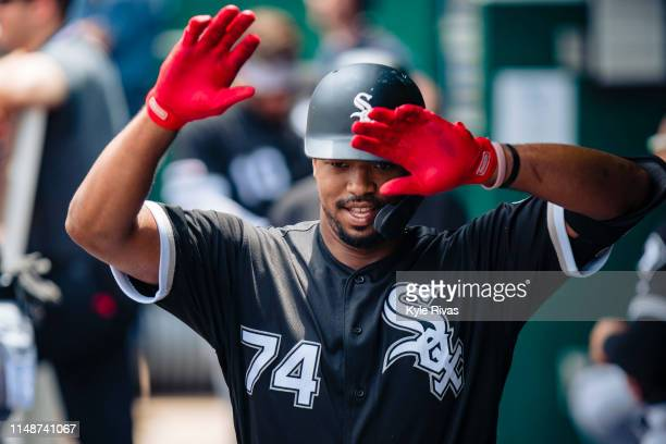 Eloy Jimenez of the Chicago White Sox celebrates without his team after hitting a single home run in the second inning at Kauffman Stadium on June 09...