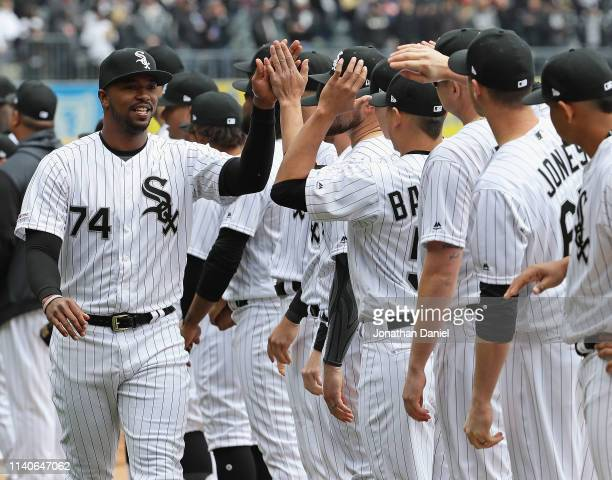 Eloy Jimenez of the Chicago White Sox greets teammates during player introductions before the season home opening game against the Seattle Mariners...