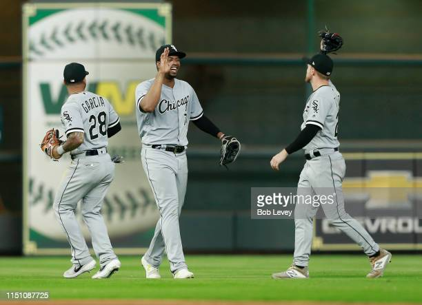 Eloy Jimenez of the Chicago White Sox high fives Leury Garcia and Charlie Tilson after the final out against the Houston Astros at Minute Maid Park...