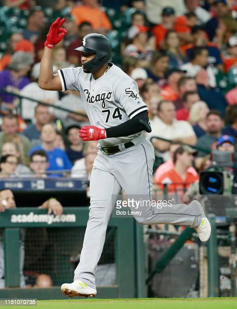 Eloy Jimenez of the Chicago White Sox hits a home run in the first inning against the Houston Astros at Minute Maid Park on May 22 2019 in Houston...
