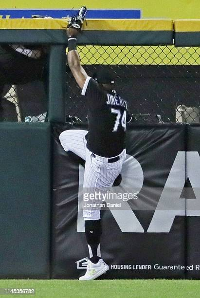 Eloy Jimenez of the Chicago White Sox hits the wall trying to catch a home run ball hit by Grayson Greiner of the Detroit Tigers in the 3rd inning at...
