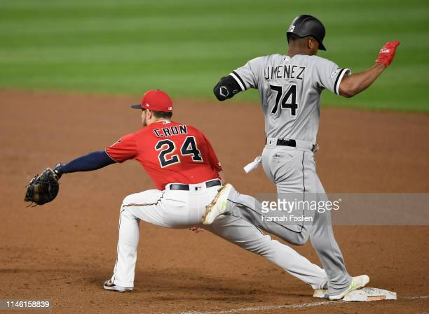 Eloy Jimenez of the Chicago White Sox is out at first base as CJ Cron of the Minnesota Twins fields the ball during the fifth inning of the game on...
