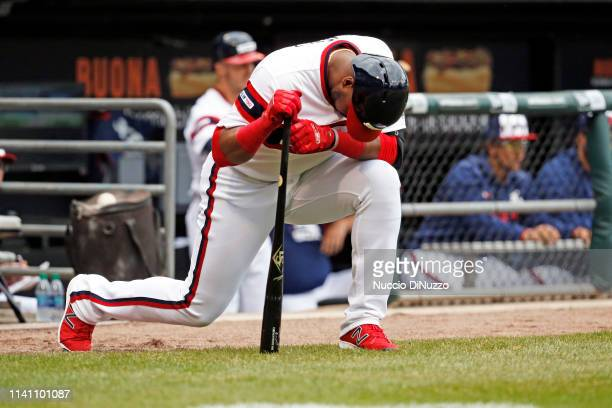 Eloy Jimenez of the Chicago White Sox kneels before batting in the second inning against the Seattle Mariners at Guaranteed Rate Field on April 07...